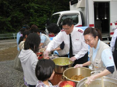 Salvation Army Officers serving food in Japan