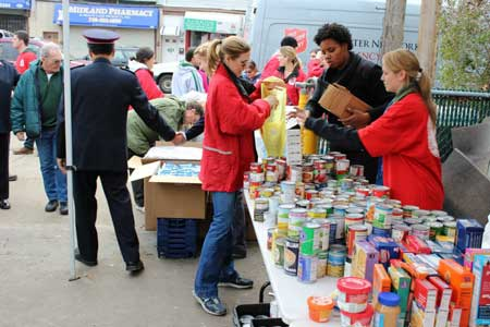 Salvation Army volunteers pass out food to Hurricane Sandy victims.