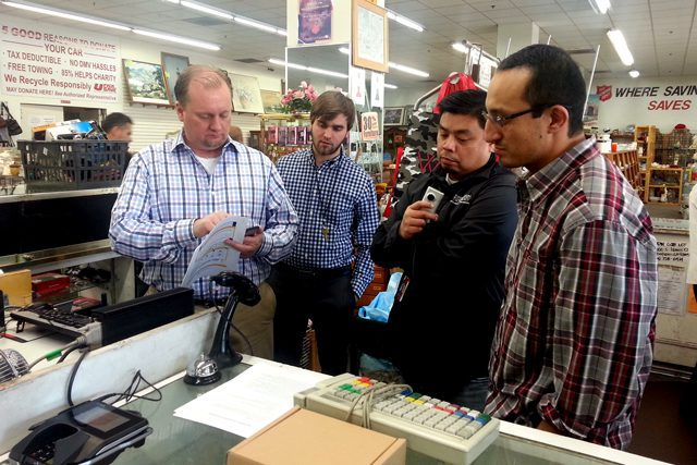 John Ickes, COO of Devnext software development firm, trains Salvation Army IT staff on how to install the MX915 tokenized credit card device.