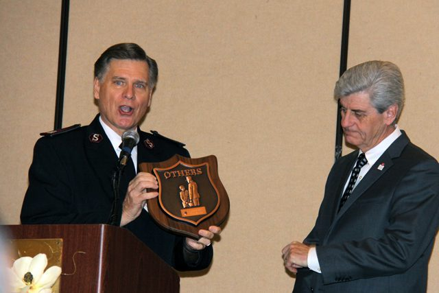 """National Commander Commissioner David Jeffrey presents Mississippi Governor Phil Bryant with an """"Others"""" award."""