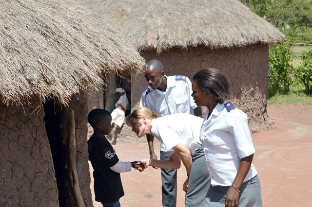 Colonel Debbie Horwood interacts with locals while visiting a village in Tanzania.