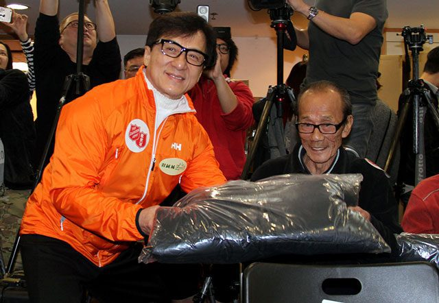 Jackie Chan delivers a jacket.