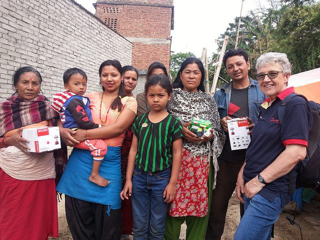 Distributing solar lamps and other essentials to members of a camp in Kathmandu