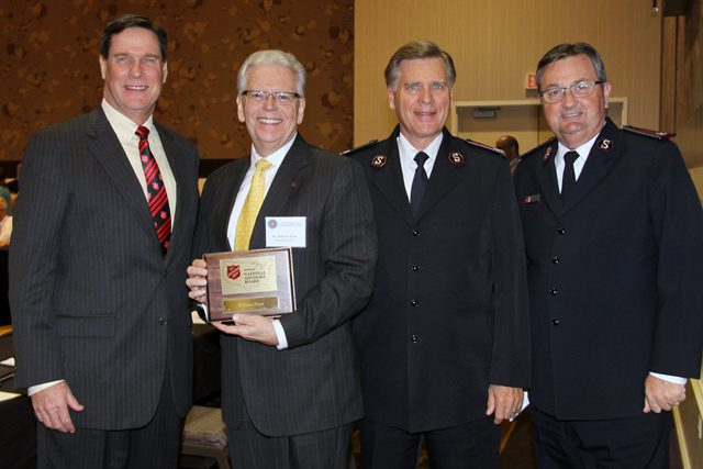 National Advisory Board Chairman Bill Burke with newly installed member Bill Flinn, the first Salvationist to serve on the board, National Commander David Jeffrey and Western Territorial Commander James Knaggs.