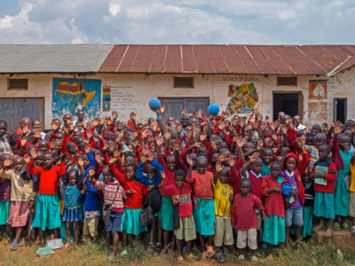 Children in Uganda smile on with the visit of One World Play Project. Photo By One World Play Project