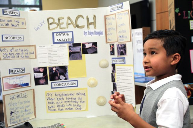 Kids show off their displays at science fair.
