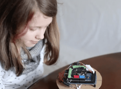 young girl with small robot