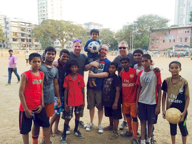 Major John Murray, David Giles and Gary Rose with the boys from The Salvation Army Jeevan Asha night shelter.
