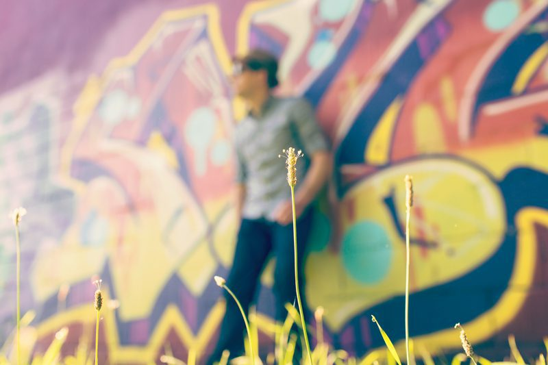 Man standing in front of graffiti wall