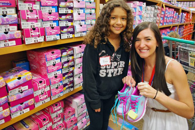Mackenzie Neitling and Bianca pick out the perfect pair of shoes during their back-to-school shopping.