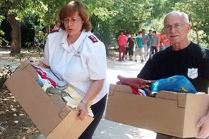 Representatives of The Salvation Army distribute supplies to refugees in Athens.