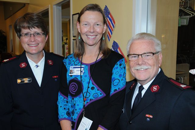 (l-r) Major Jeanne Baker, Alaska divisional director of women's ministries, Cathy Brenner, Serendipity director, and Major George Baker, divisional commander, greet the Red Shield Society event attendees.