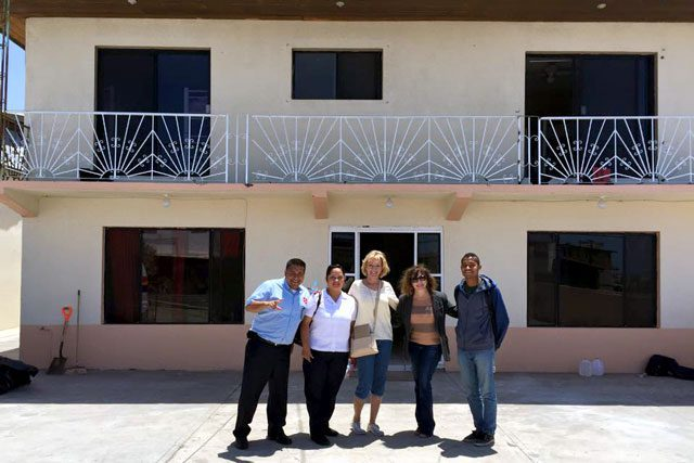 Army staffers outside of Casa Puerta de Esperanza prior to the grand opening.
