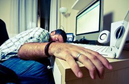 man asleep at desk