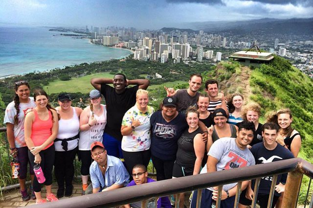 Members of Revolution Hawaii at the top of Oahu's Diamond Head.