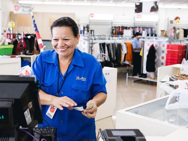 Woman smiling behind cash register
