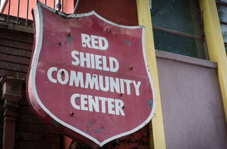 red shield community center sign