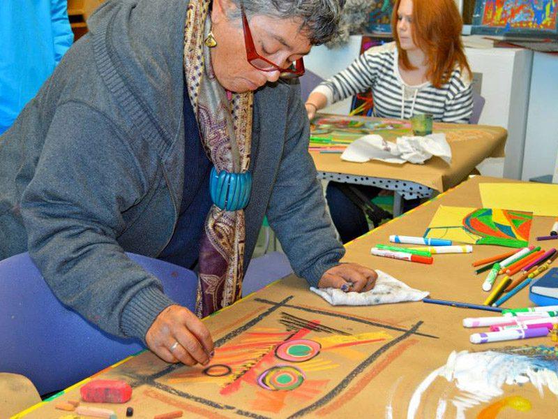 Older Woman doing art