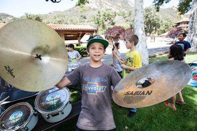 Child with tambourines