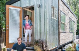 Macy Miller and husband in front of house
