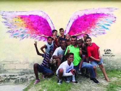 People posing in front of angel wings