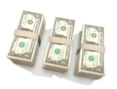 Thee stacks of dollar bills