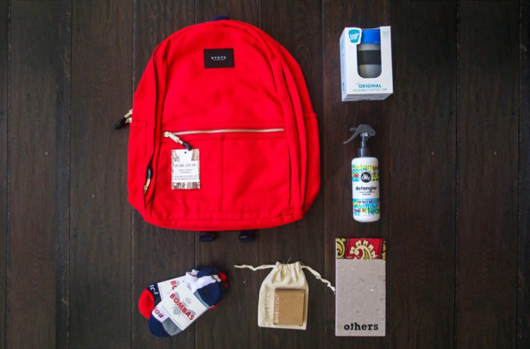 backpack with different products outside