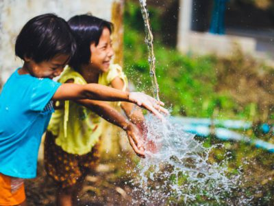 children playing with water outside
