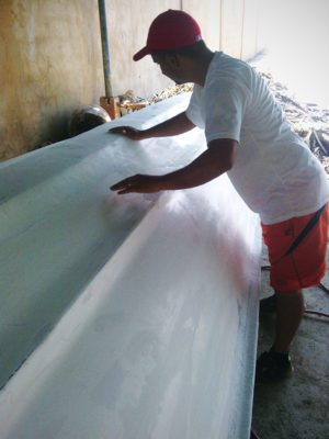 "Lt. Edicson Sanchez, ""Pesca Milagrosa"" (Miraculous Fishing) program director, works on a fishing boat for the ministry."