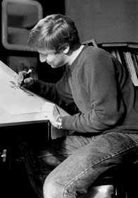 "At his drawing table in his Yale dorm, David smiles as ""The Jester"" takes shape."