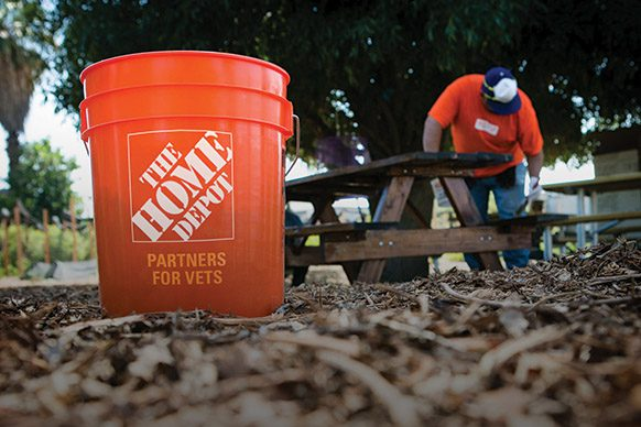 Home Depot bucket in front of volunteer working