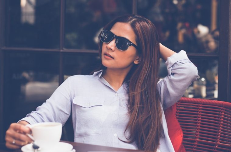 Woman sitting outside with coffee