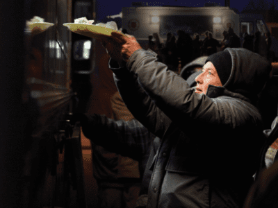 Man being given food