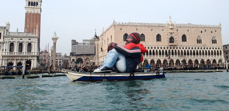 """""""Inflatable Refugee"""" on boat in water"""