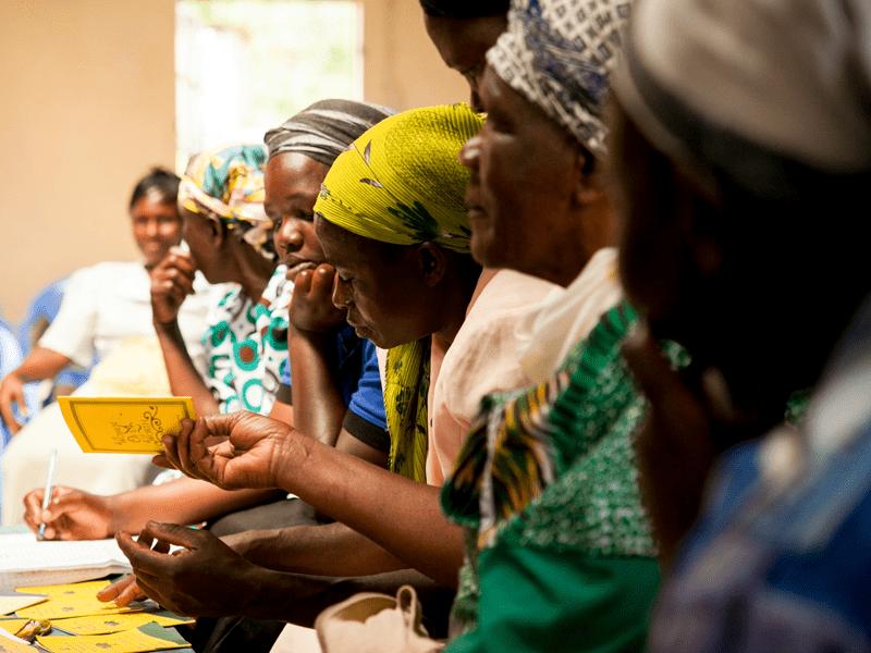 Kenyan women sitting inside