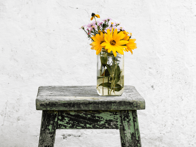 Flowers in vase on stool