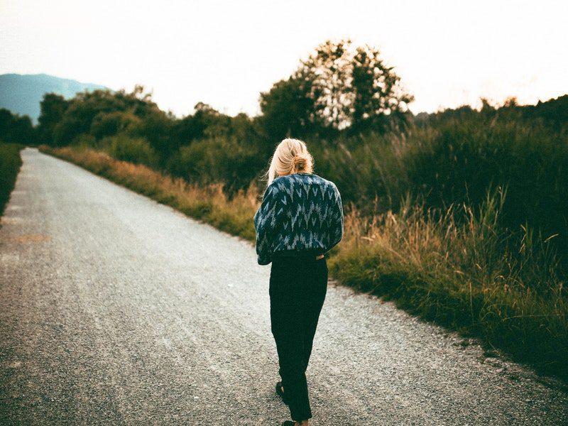 Woman walking alone outside