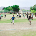 Children running on field