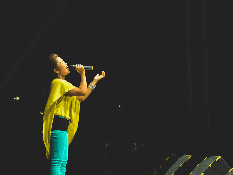 woman in yellow top singing