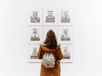 Woman looking at pictures on wall