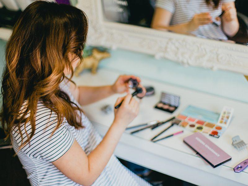Daughter holding makeup
