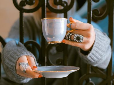hands holding cup and plate