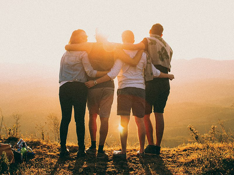Group of people with arms around each other