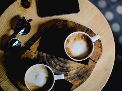 Two cups of coffee on table