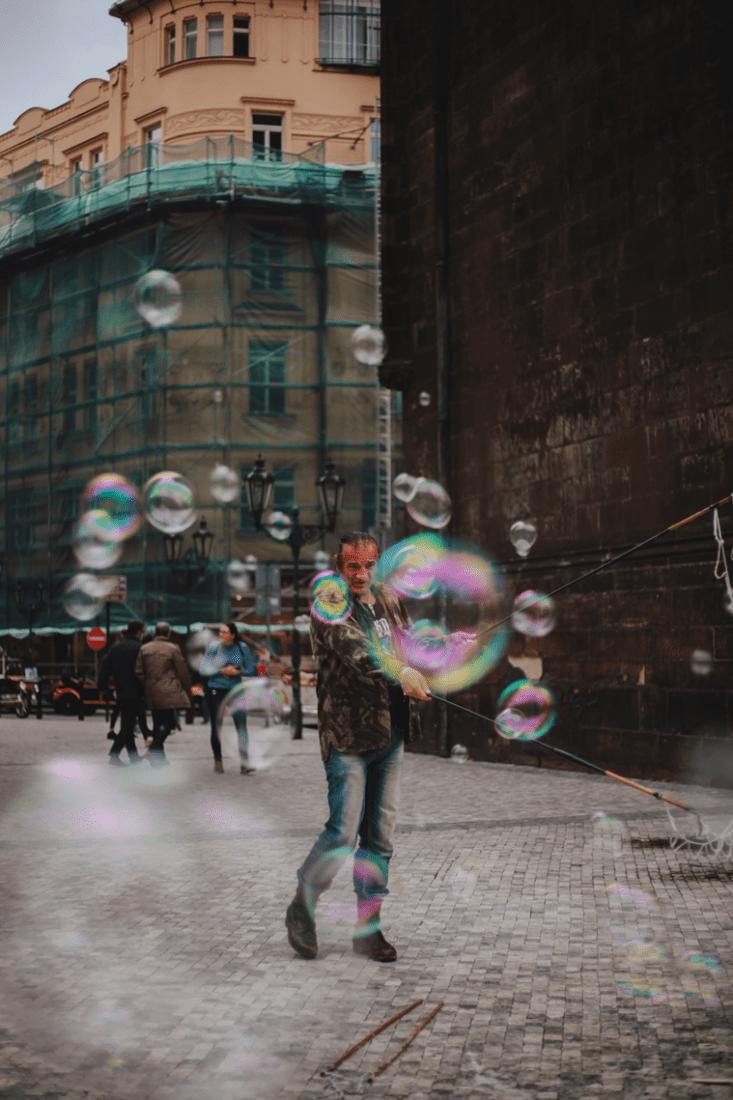 Man making bubbles in street