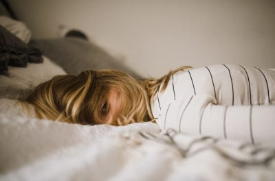 Woman laying face down in bed