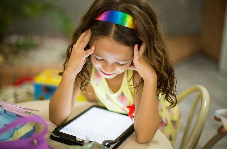 young girl looking at iPad
