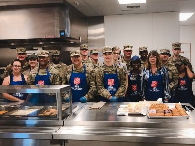 US Army personnel standing together in kitchen