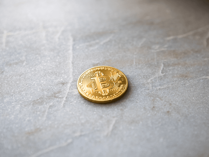 Closeup view of gold coin with bitcoin logo