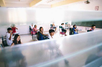 children sitting at desks in school